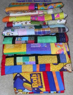 stack of 10 quilts