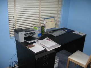My desk showing the HP Officejet 5610 and the HP Pavilion computer with 17-inch flat-panel display