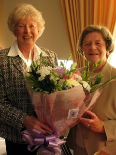 Constance Wright presented with a bouquet of flowers from New Captain Pat Walker