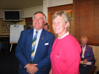 Helen receives her runners up prize from the club captain -- click to enlarge