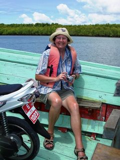 Mum on the ferry to Koh Yao Noi with motorbike for company