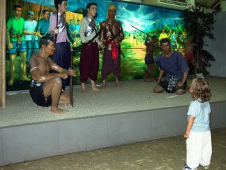 My son watches the people of Phuket getting ready to fight the Burmese