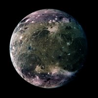 In this global view of Ganymede's trailing side, the colors are enhanced to emphasize color differences.