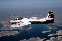A T-37 Tweet aircraft from the 85th Fighter Training Squadron, Laughlin AFB, Texas, flies over Lake Amistad during a training mission. The T-37 Tweet is a twin-engine jet used for training undergraduate pilots, undergraduate navigator and tactical navigator students in fundamentals of aircraft handling, and instrument, formation and night flying. The twin engines and flying characteristics of the T-37 give student pilots the feel for handling the larger, faster T-38 Talon or T-1A Jayhawk later in the undergraduate pilot training course. The instructor and student sit side by side for more effective training. The cockpit has dual controls, ejection seats and a clamshell-type canopy that can be jettisoned. (Air Force photo by Staff Sgt. Andy Dunaway)