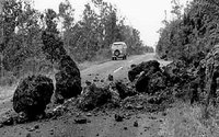 Photograph by Boone Morrison, Small landslide from spatter and cinder cone partially blocking, Chain of Craters Road, Hawaii Volcanoes National Park.