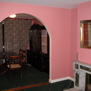 Pink sitting room with a real fireplace.