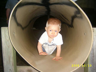 Crawling through tube at playground