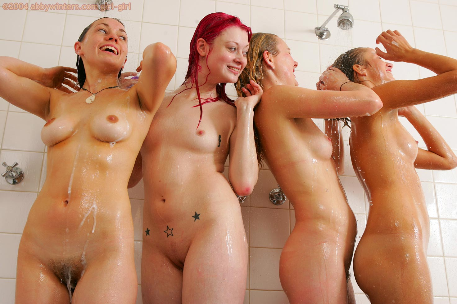 nude women showering together