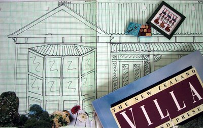 Sketch of a typical New Zealand bay villa, with a book on the subject and a couple of dolls' house miniature pieces on top of it.