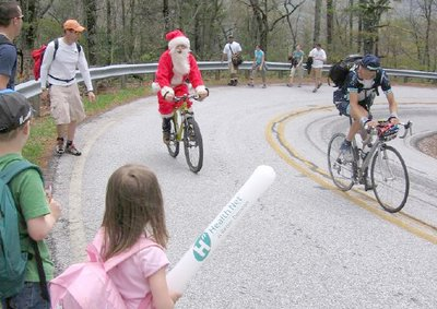 Image of Santa Claus on a bike
