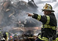 Retired fire chief Joseph Curry barks orders to rescue teams as they clear through debris that was once the World Trade Center Sept. 14, 2001, in New York. Photo by Photographer's Mate 1st Class Preston Keres, USN