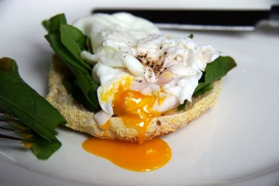 photograph picture of a homemade English muffin with a poached egg and sorrel recipe.