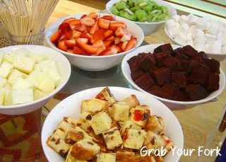 fruits, cake squares and marshmallows for chocolate dipping
