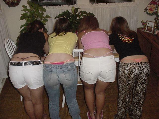 Girls in thongs bending over