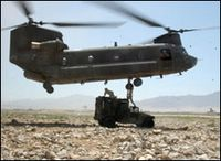 Soldiers sling-load a vehicle to a CH-47 Chinook helicopter during an operation near Bagram, Afghanistan. The Soldiers are assigned to the 25th Infantry Division, supporting the Joint Logistics Command during Operation Enduring Freedom. This photo appeared on www.army.mil. July 29, 2004 by Sgt. 1st Class Sandra WatkinsKeough