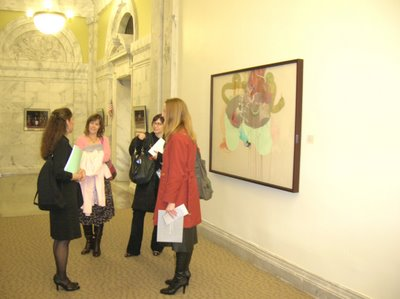 Curators in front of Maggie Michael painting
