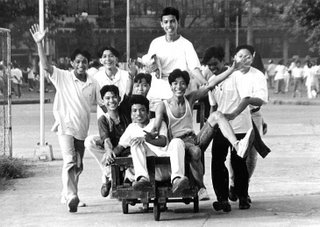If the subject is moving away from or towards the camera, you can use 1/60 sec. or slower since the camera senses little movement in this kind of situation.; Rizal High School 1993; photo by Atty. Galacio
