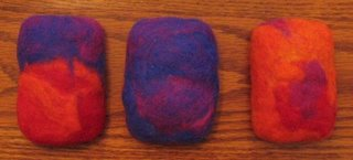 3 felted soaps in bright colors.