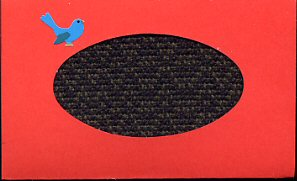 Red card with handwoven black & green shadow weave inset & bluebird sticker.