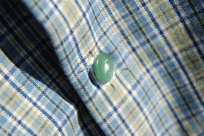 center front button band on plaid jacket