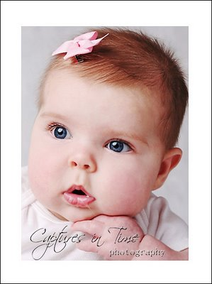 kansas city sister photographer baby with pink bow