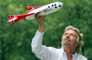 Sir Richard with a model of Spaceship Two