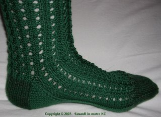 foot of green knee sock