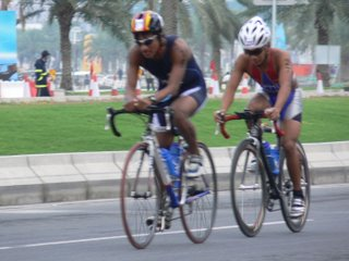 Two cyclists battle it out on Doha's Corniche