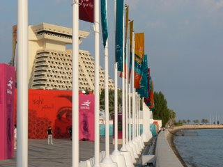 flags wave along the edge of the Corniche