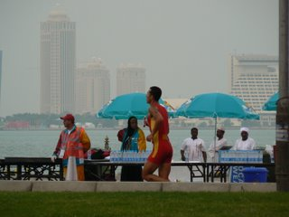 A runner passes by, with the Sheraton hotel in the background