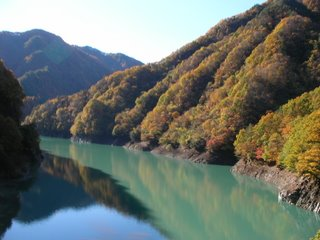 The autumnal slopes and aquamarine water of Koshibu valley