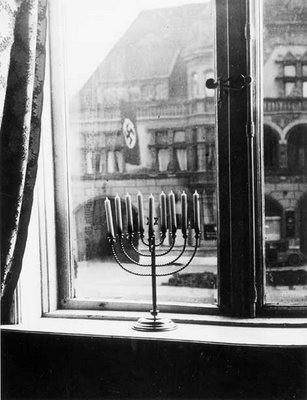 Menorah in window opposite town hall of Kiel, Germany, 1933