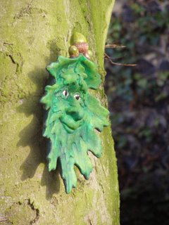 A ceramic face on a tree