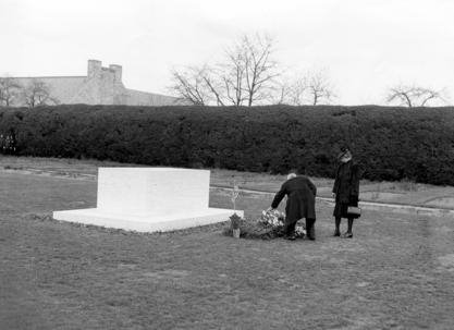 "President Harry S Truman with Mrs. Roosevelt placing flowers at FDR""s grave"
