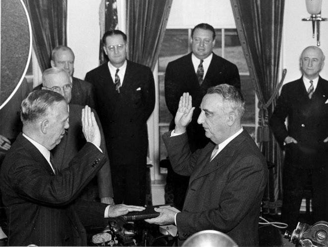 Harry Truman watches George C. Marshall take oath as Secretary of State