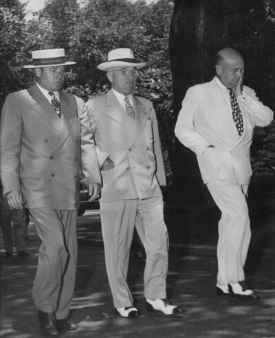 President Truman walks with aids soon after news of Chinese entry into Korean conflict