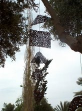 mobile on tree in park of the gallery in cultural place of cyprus
