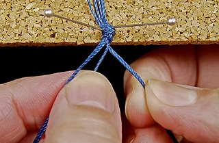 My hands doing finger weaving